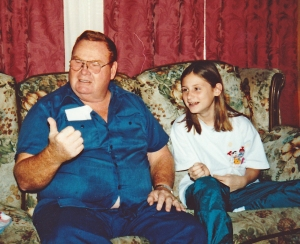 Dad and my youngest daughter.  I'm sure he was telling about her cheating on computer games.