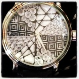 My new watch featuring one of my tiles.